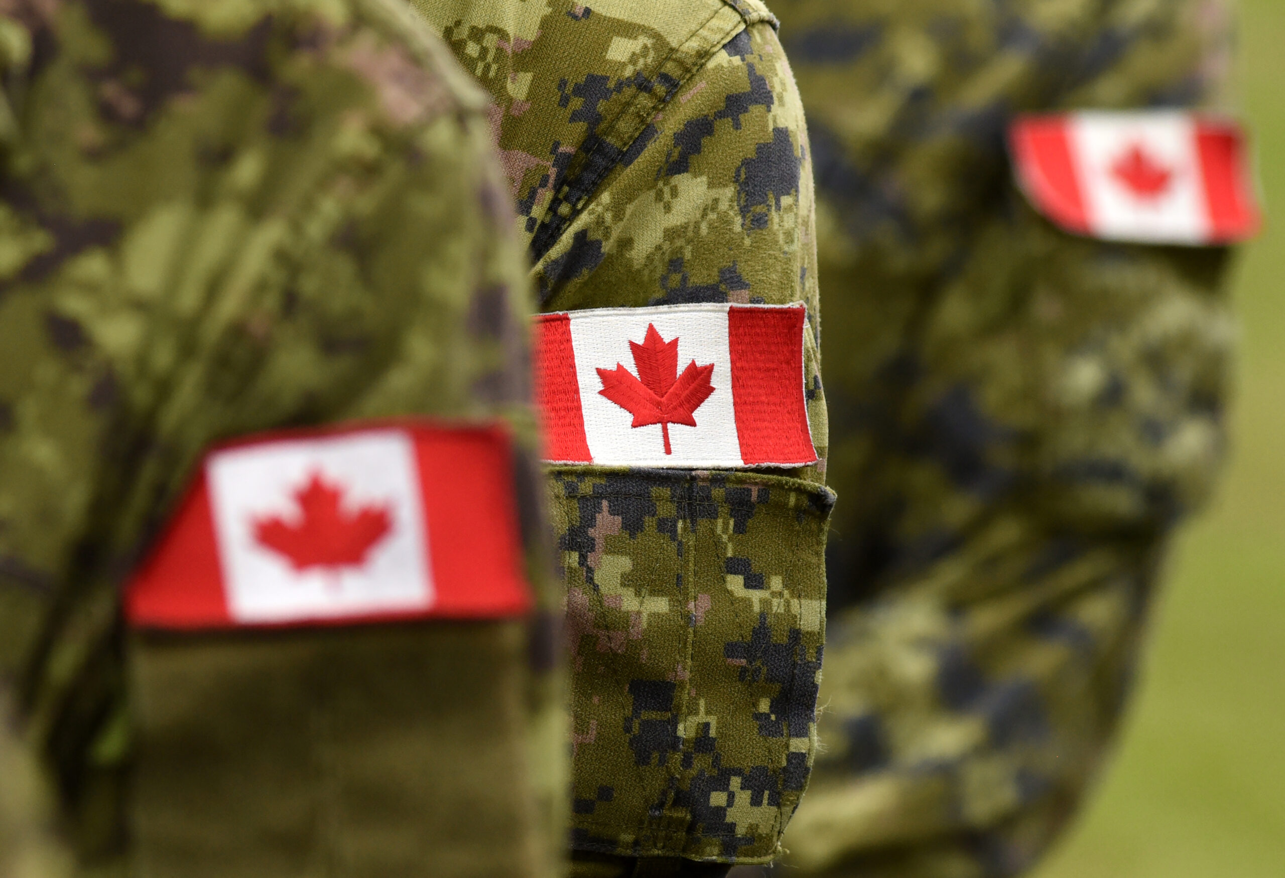Flag,Of,Canada,On,Military,Uniform.,Canadian,Soldiers.,Army,Of